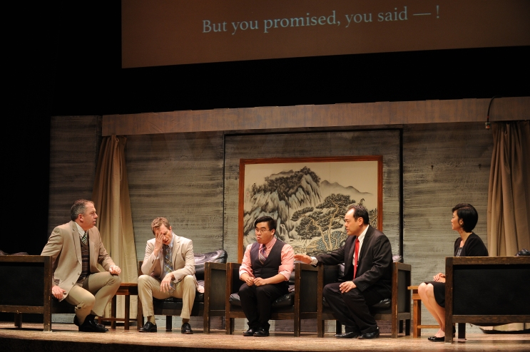 Unhappy negotiations – Michael T. McCune as Peter Timms, Chris Mahle as Daniel Cavanaugh, Phil Wong as Bing, Jeffrey Sun as Minister Cai Guoliang, Joyce F. Liu as Xi Yan in the Palo Alto Players production of David Henry Hwang's Chinglish running through June 28 at the Lucie Stern Theatre in Palo Alto. Photo: Joyce Goldschmid