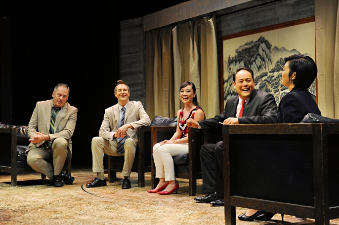 Happy negotiations – Michael T. McCune as Peter Timms, Chris Mahle as Daniel Cavanaugh, Dianna Hua Chung as Miss Qian, Jeffrey Sun as Minister Cai Guoliang, Joyce F. Liu as Xi Yan in the Palo Alto Players production of David Henry Hwang's Chinglish running through June 28 at the Lucie Stern Theatre in Palo Alto. Photo: Joyce Goldschmid