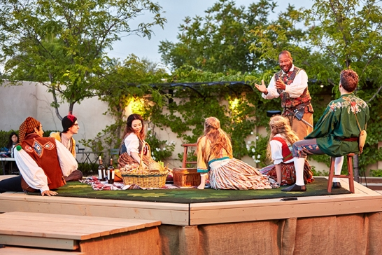 Michael Wayne Rice as Jacques and the cast of As You Like It. Costumes by Barbara Murray. Photo: Gregg Le Blanc