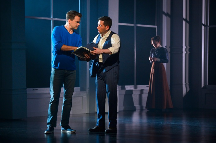 Brian (Ross Lekites) explains the connection they share with the Triangle Shirtwaist Factory to Ben (Zachary Prince) as a vision of Sarah (Megan McGinnis) lingers in the background in TheatreWorks Silicon Valley's World Premiere of Triangle playing July 8 - August 2 at the Lucie Stern Theatre in Palo Alto. Photo: Kevin Berne