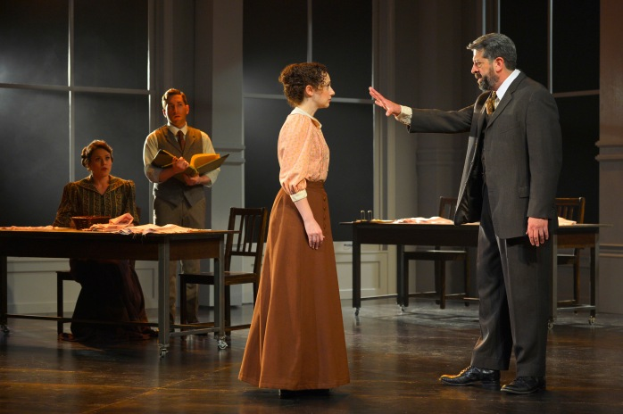 L-R Theresa (Laura D'Andre) and Vincenzo (Zachary Prince) see Sarah (Megan McGinnis) fired from her job in the Triangle Shirtwaist Factory by her boss (Rolf Saxon) in TheatreWorks Silicon Valley's World Premiere of Triangle playing July 8 - August 2 at the Lucie Stern Theatre in Palo Alto.  Photo: Kevin Berne