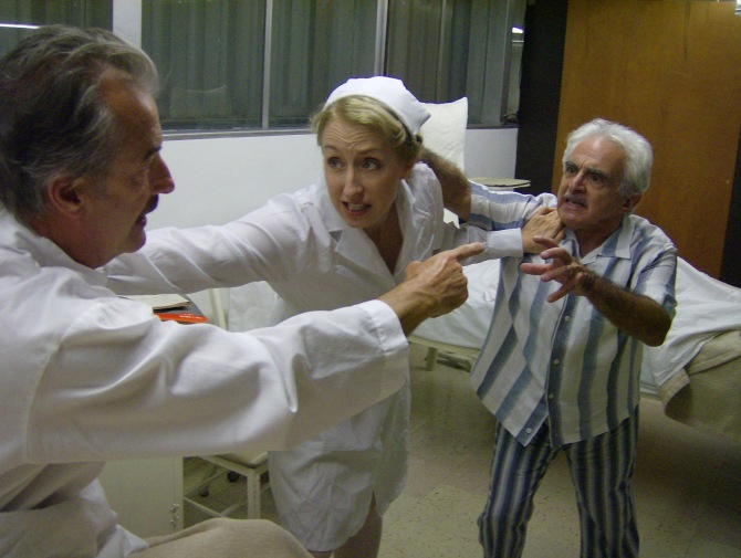 "John Nielsen as Rudolph Schindler, Heather Robinson as Nurse Rothstein and Ray Xifo as Richard Neutra in the Ensemble Studio Theatre/Los Angeles production of Tom Lazarus' ""The Princes of Kings Road,"" now playing through October 4 at The Nuetra Institute and Gallery in Silverlake. Photo courtesy of EST/LA"
