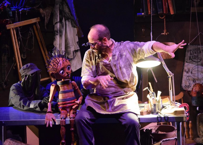 Puppet (Rudy Martinez, with puppeteers Lisa Dring and Mark Royston) and Geppetto (Ben Messmer). Photo: Chelsea Sutton
